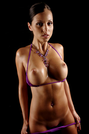 Sexy Latin babe Janessa Brazil shows her hot body in a purple bikini