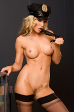 Hot blonde babe Kayden Kross strips naked from her cop uniform
