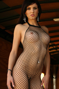 Autumn Prescott from NextDoor-Models poses in and strips of a black body stocking